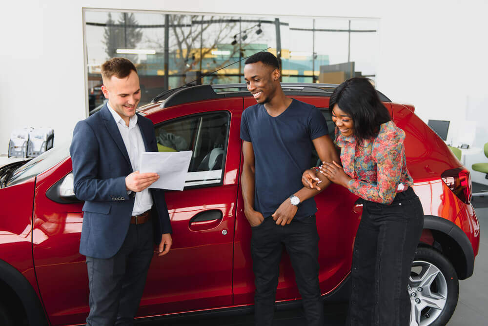African American couple new car shopping