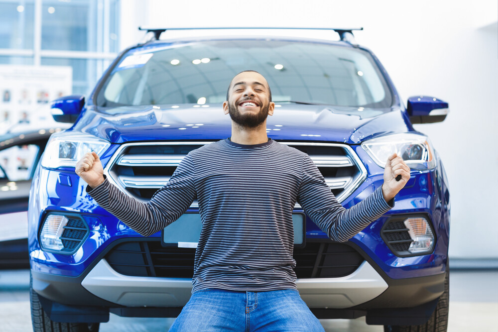 Man excited about a new car