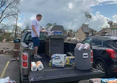 Tyson Madliger cooking from the back of a truck - tornado relief